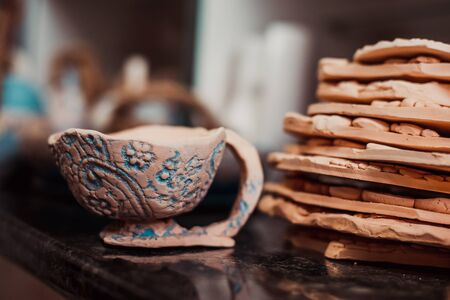 limbo: Products made of clay. Pottery of different sizes exhibited in shelf