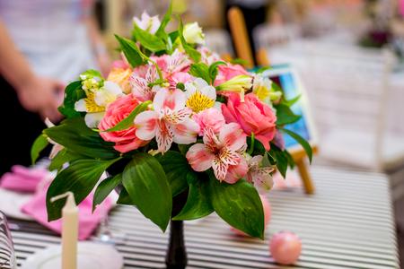 eclecticism: Elegant red flowers bouquet standing on table. Elegant red flowers bouquet standing on table
