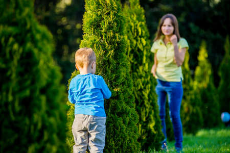 warm weather: Happy mother and adorable little boy enjoying warm weather at beautiful park