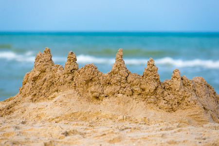 sandy castle at the sea edge. sandy castle at the sea edge Stock Photo