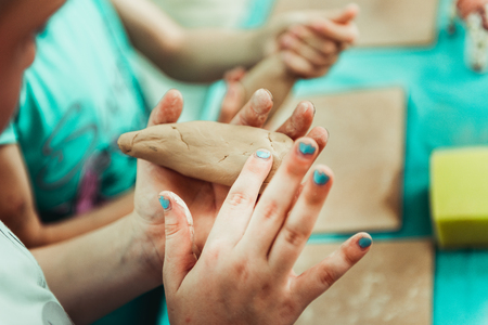 childrens hands sculpts clay crafts pottery school
