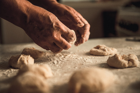 homemade cakes of the dough in the womens hands. The process of making pie dough by hand Stock fotó