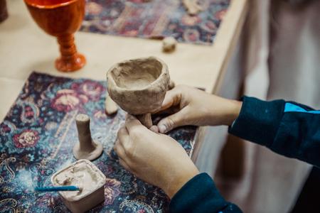 slavs: childrens hands sculpts clay crafts pottery school