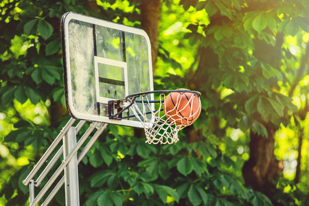 Basketball basket with all going through net. Basketballs hit the basket Stock Photo