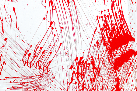 Blood splatter, red acrylic paint splash isolated on wall background texture grunge. Blood splash, spray. Abstract blood decoration. Murder and killing. Close up.