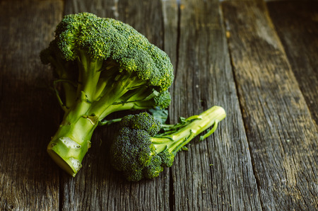 Broccoli. Raw fresh broccoli on old wooden table. Stock Photo