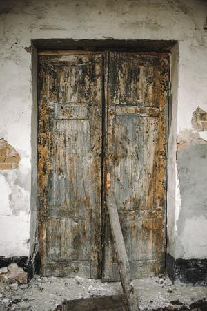 door knob: The texture of old door, which the old paint flaking