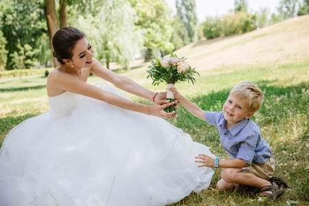 Little boy giving flower to his mom Stock Photo
