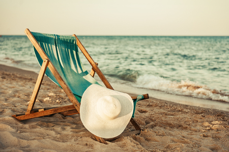Beach Chair. hat and sea view. The concept of rest Stock Photo