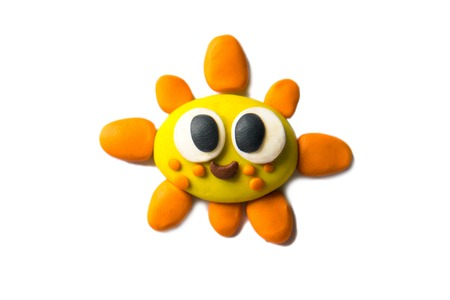 Modeling sun of plasticine. Photo illustration.