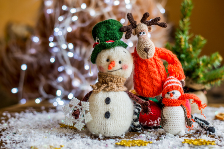 Handmade yarn snowman holding gifts in a sock, boot. Christmas and New Year Stock Photo