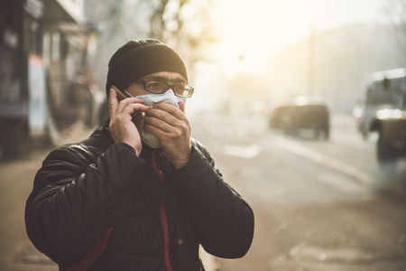 A man wearing a mask on the street. Protection against virus and grip 版權商用圖片 - 91597426