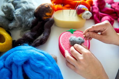 Manufacturing process from wool soft toys. Felting activity Stock Photo