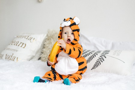 baby wearing tiger suit
