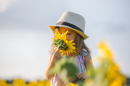 Child and sunflower, summer, nature and fun. Summer holiday.