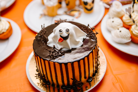 Sweets, treats for the holiday of Halloween.Celebratory Cake with ghost on Halloween