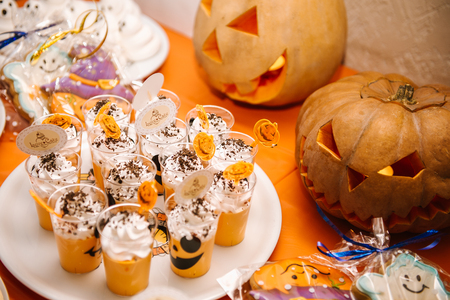 Sweets, treats for the holiday of Halloween. Funny meringue ghosts for Halloween party Фото со стока
