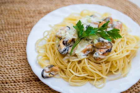 Traditional italian seafood pasta with clams. Spaghetti with mussels in creamy sauce