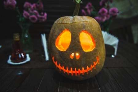 Grinning pumpkin lantern or jack-o- is one of the symbols Halloween. 版權商用圖片 - 113574241