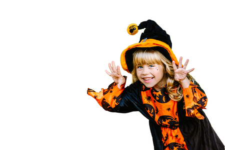 Halloween concept. Little girl dressed up as a witch isolated on white