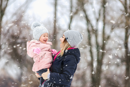 happy mother and child in the park in winter.