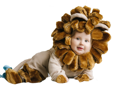 Handsome plump little child in a lion costume. 스톡 콘텐츠