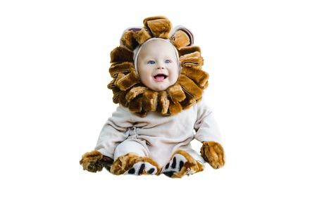 Handsome plump little child in a lion costume. 版權商用圖片