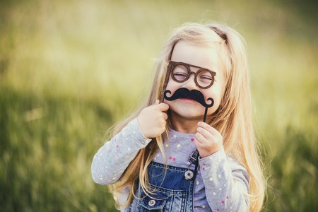 Funny baby with a mustache and glasses. Happy fathers day. Selective focus. Stock fotó