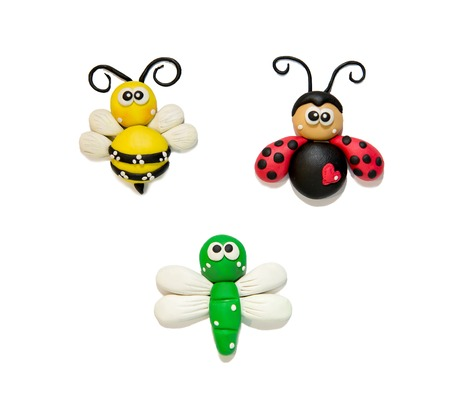 modeling clay beetles, insects, on a white background. Funny plasticine beetles. Bee, coccinella, dragonfly from plastic