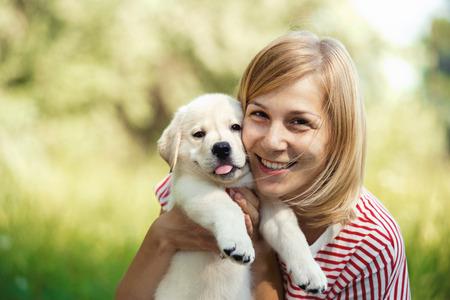 Girl with labrador puppy Stockfoto