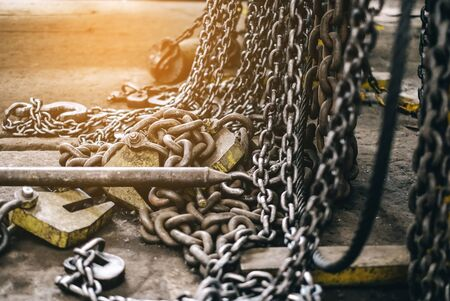many metal chains in an industrial plant