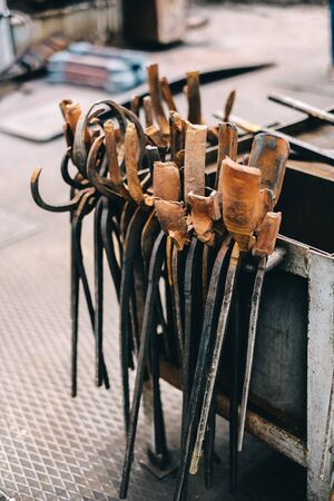 old tool, rusty tongs in a blacksmith