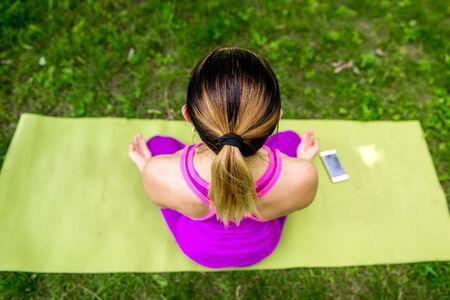 woman meditating on nature Reklamní fotografie