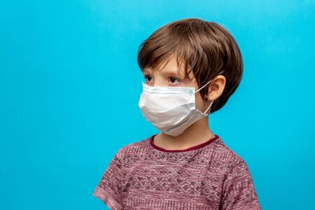 boy in a medical mask on a blue background