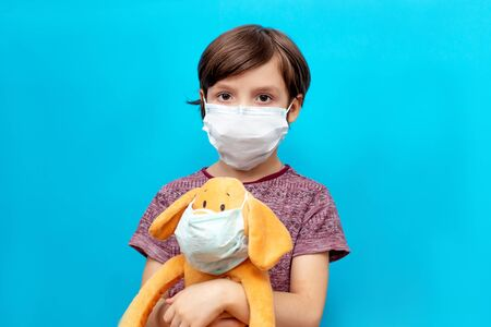 sick child in a mask with a toy. Flu epidemic, virus