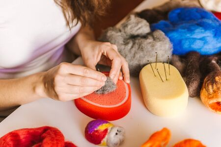 Needlewoman decorating handmade craft, art therapy, sewing concept. Felting