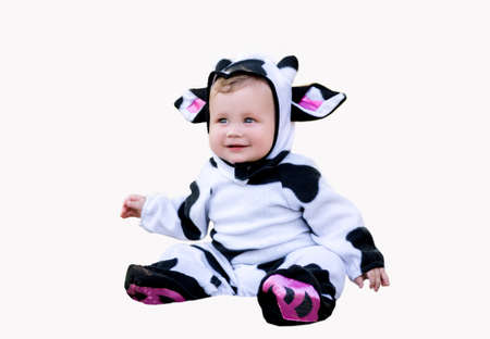 Year of the bull. A baby in a fancy dress cow costume on a white background