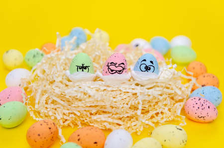 Funny eggs with eyes, masked for Easter. Standard-Bild