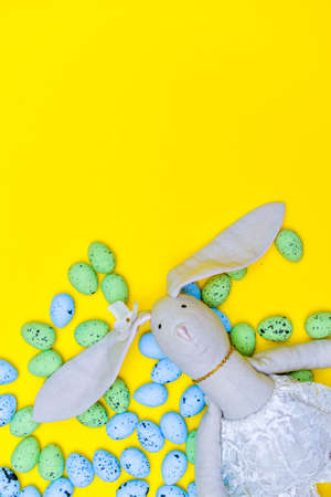 Colorful easter eggs with easter bunny on yellow paper background