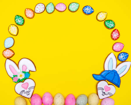 Easter pastry background. Colorful icing Easter cookies, with different symbols and decorations. Traditional easter sweets flat background