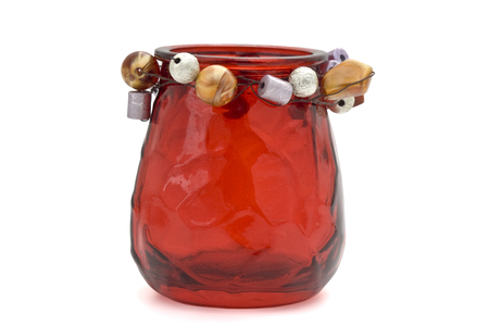 votive candle: Red votive candle holder with decorations isolated on white. Stock Photo