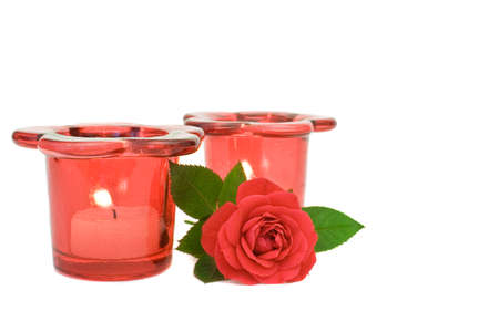 votive candle: A red rose and two red votive candle holders on white background Stock Photo