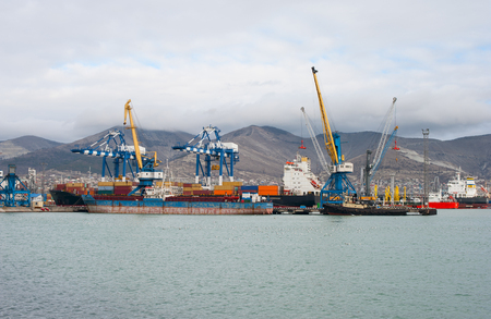 sea freight: Sea freight industrial port on a background of mountains