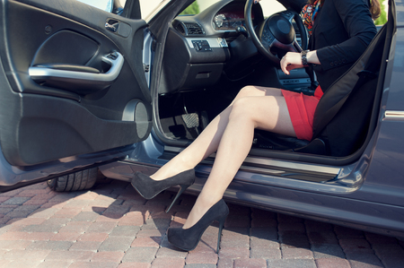 shapely legs: Shapely female legs in the car background