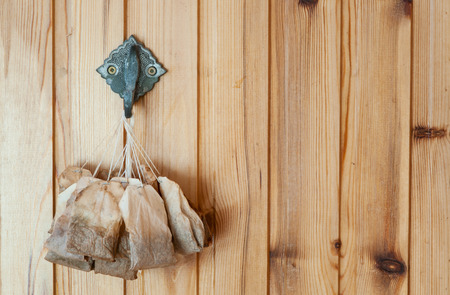 frugality: Used tea bags drying on the wall Stock Photo