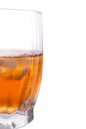 gold whiskey in glass with ice isolated on white background Stock Photo - 5451140