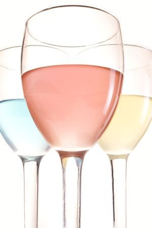 three glasses with red blue and yellow drinks Stock Photo - 5451149