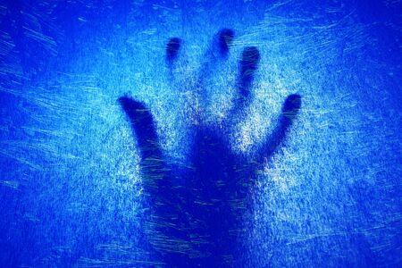 paranormal: hand under ice Stock Photo