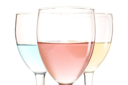three glasses with red blue and yellow drinks Stock Photo - 5465200
