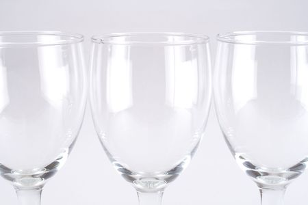 three wineglasses in a row isolated on grey background Stock Photo - 5465207